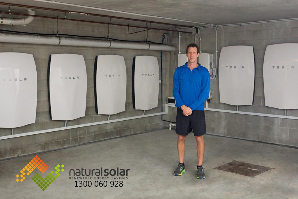 Clayton Lyndon proudly displaying his 6 Tesla Powerwall installation by Natural Solar