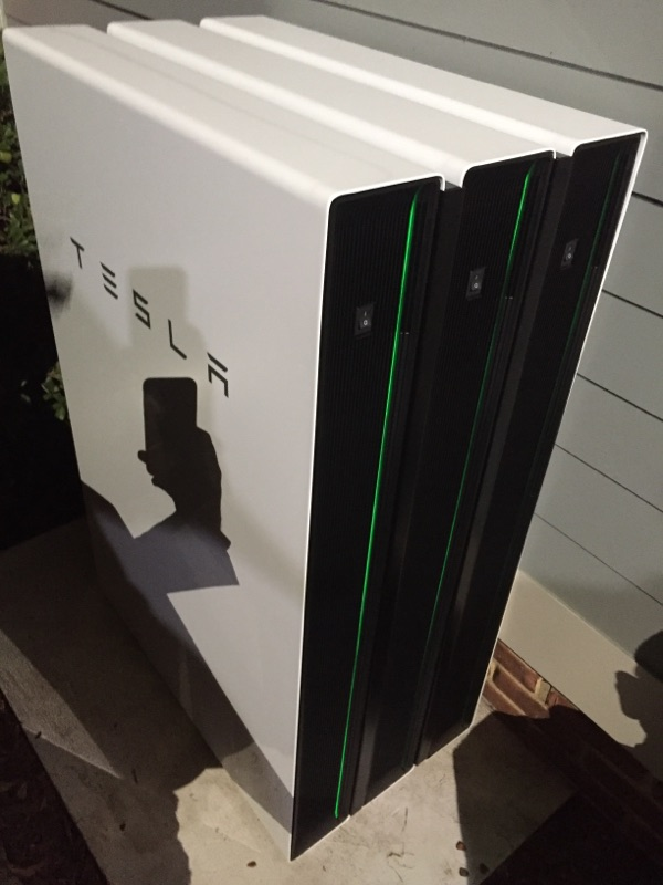 3-powerwall-2s-stacked-and-laying-on-the-floor